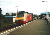 Aberdeen bound HST at Kirkcaldy in July 1998 with Virgin XC liveried power cars and carriages in IC colours.<br><br>[David Panton&nbsp;/07/1998]