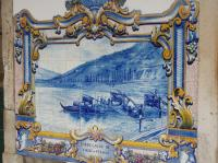 A close up of one of the many tile pictures on the exterior walls of Pinhao station. This one depicts a scene in the Douro Valley with Port barrels being loaded onto a boat, for transport downstream to Porto and export probably.  <br><br>[Mark Bartlett&nbsp;04/02/2007]
