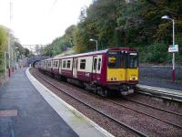 314 214 with a service for Glasgow via Queens Park at Kirkhill on 13 October 2007.<br><br>[David Panton&nbsp;13/10/2007]