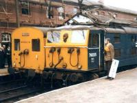 Class EM1 76025 with the LCGB <I>Easter Tommy</I> railtour at Guide Bridge alongside class 506 Hadfield/Glossop DC unit M59601M on 21 April 1981. The tour started at Lime Street with a pair of 25s and arrived in Lincoln behind a pair of 31s with 76025 handling the Guide Bridge - Rotherwood leg.<br><br>[Colin Alexander&nbsp;21/04/1981]