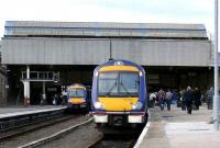 Busy Perth on 14 March with the 1355 to Inverness boarding in platform 4 and 170430 on the right bound for Edinburgh.<br><br>[Brian Forbes&nbsp;14/03/2007]