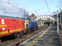 47848 passing through Johnstone station with a Royal Mail Class 325 in tow whilst on a driver training run from Ayr to Shieldmuir<br><br>[Graham Morgan&nbsp;16/03/2008]