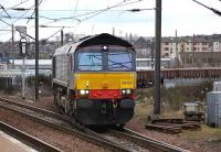 After leaving the <I>sub</I> at Craiglockhart Jct on 18 March, DRS 66423 comes off the spur to join the Edinburgh - Carstairs line at Slateford Jct and is about to run through the station with a train of EWS ballast trucks.<br><br>[Bill Roberton&nbsp;18/03/2008]