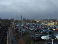 The car park at Johnstone station on 5th March. This is a typical weekday where there are too many cars and not enough spaces, as shown by the three cars parked next to the closest lamp post which have yellow stickers on them. This was the location of Johnstone shed and goods depot. <br><br>[Graham Morgan&nbsp;05/03/2008]