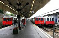 District Line trains occupying platforms 1,2 and 3 at Wimbledon terminus on 3rd July 2004.<br><br>[John Furnevel&nbsp;03/07/2004]