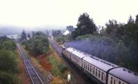 An Oban - Glasgow Queen Street service approaching Crianlarich in 1987 with the former route to Callander running off to the left and passing below the Fort William line. <br><br>[Ian Dinmore&nbsp;//1987]