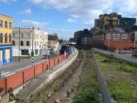 The abandoned Silvertown station in East London looking towards the Connaught Tunnel and North Woolwich on 21 March 2008, with North London Line trains now terminating at Stratford. On the right stands the Tate & Lyle sugar refinery.<br><br>[Michael Gibb&nbsp;21/03/2008]