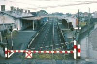 Looking over the station at Tuam, County Galway, from the level crossing on a wet day in 1988.<br><br>[Bill Roberton&nbsp;//1988]