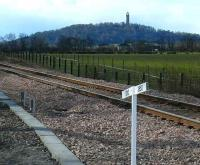 Linear Alignment. Looking west from Blackgrange crossing on 24 March, a new gradient marker below the Wallace Monument.<br><br>[Brian Forbes&nbsp;24/03/2008]