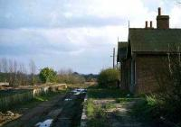 The remains of Drayton station on the Midland & Great Northern Joint line from Norwich City to Melton Constable in 1977. Closed to passengers in 1959, the station saw its last train in 1969 and was finally demolished in 1979. There was nothing left to harm in 1989....<br><br>[Mark Dufton&nbsp;/03/1977]