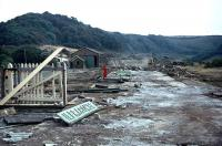 Preservation attempts having failed, Ilfracombe station is bulldozed into rubble in September 1976. Hopefully, the station nameplate (cast concrete and far too heavy to <I>rescue</I>) has survived somewhere.<br><br>[Mark Dufton&nbsp;/09/1976]