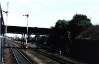 Photograph taken from a train passing Elderslie West Junction on 28th July 1975. All that remained of the station at this time was the foot bridge, now demolished. Where the trucks are stabled next to No.1 SB is now part of the  National Cycle Network. <br><br>[Graham Morgan Collection&nbsp;28/07/1975]
