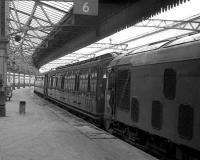 Empty stock of the Royal Train stands at Aberdeen platform 6 in May 1973 as the driver of the class 24 keeps an eye on proceedings.<br><br>[John McIntyre&nbsp;26/05/1973]