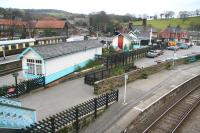 Looking southwest from the footbridge over Grosmont station towards the village in April 2008. On the left are the NYMR platforms with the level crossing in the centre background and the line to Pickering entering the north portal of Grosmont tunnel beyond. At the bottom right of the picture stands the Whitby - Middlesbrough platform with the line turning off to the west towards Battersby. <br><br>[John Furnevel&nbsp;03/04/2008]