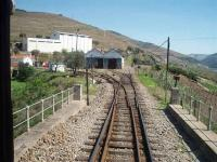 Mixed gauge tracks. The broad gauge Douro line and the metre gauge Corgo line ran as mixed gauge east from Regua station across the Corgo river before separating. Corgo station can be seen on the left as can the narrow gauge depot and the line curving left to run to Vila Real. Straight on for Pinhao and Pocinho. The metre gauge line has since been closed.<br><br>[Mark Bartlett&nbsp;20/03/2008]
