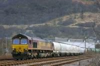 Fort William - Mossend freight (consist 12 Alcan PCA and 5 TTA tanks) being reversed out of Fort William yard by EWS 66099 on 8 April 2008. <br> <br><br>[Bill Roberton&nbsp;08/04/2008]