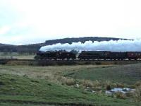 45407 and 60009 are seen north of Moy on the last stretch of single line before Inverness.<br><br>[John Gray&nbsp;13/04/2008]
