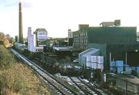The site of Alloa (New) station in November 1985, then covered by the brewery complex. Remarkably, only the railway line survives in the modern view. The new station platform follows the course of the trackside railings and the new shelter is roughly at the site of the white storage tanks. [See image 18650]<br><br>[Mark Dufton&nbsp;/11/1985]