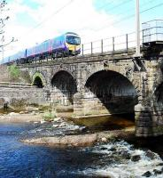 Northbound First service crossing the Six Arch Viaduct (or Wyre Bridge on an OS map!) at Scorton.<br><br>[Ewan Crawford&nbsp;14/04/2008]