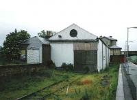 Looking north over the down platform and part of the former goods yard and sheds at Markinch in July 1998. The original 1847 E&N station building in the background still stands although operational activities are now handled by a modern interchange recently opened on the site of the former yard.<br><br>[David Panton&nbsp;/07/1998]