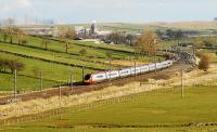 A northbound Pendolino leaving Shap with the the town and Hardendale Quarry as a backdrop.<br><br>[Ewan Crawford&nbsp;14/04/2008]