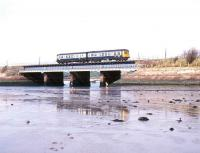 A class 108 DMU crossing Ravenglass Viaduct on the Cumbrian coast on a sunny 3 May 1990.<br><br>[Ian Dinmore&nbsp;03/05/1990]