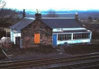 Remains of Millerhill station, standing at the south end of Millerhill yard in April 1985. The building has since been converted into a house.<br><br>[David Panton&nbsp;/04/1985]