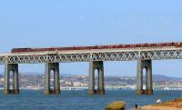 First outing of <I>The Royal Scotsman</I> in 2008. The train, hauled by 47804, is seen crossing the Tay Bridge on 21 April heading for Dundee and eventually Keith. Below the bridge a father watches his son and labrador at play.<br><br>[Brian Forbes&nbsp;21/04/2008]