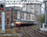 A class 320 at Dalmuir approaching platform 2 (and therefore running <I>via Singer</I>) on 19 April 2008.<br><br>[David Panton&nbsp;19/04/2008]