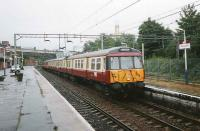 A 6-car 303 with a service to Dalmuir stands at Motherwell platform 4 in September 1997. <br><br>[David Panton&nbsp;04/09/1997]