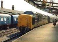 Deltic 55002 <I>The Kings Own Yorkshire Light Infantry</I> brings a <I>Merrymaker</I> excursion from Newcastle into Whitby on 2 August 1981. A DMU on an Esk Valley service stands at the other platform. <br><br>[Colin Alexander&nbsp;02/08/1981]