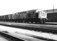 A southbound freight hauled by EE Type 4 D351 runs past the former steam shed at Carlisle Kingmoor in April 1971. <br><br>[John Furnevel&nbsp;02/04/1971]