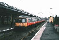 A 6-car 303 arrives at Milngavie on 30 March 1998.<br><br>[David Panton&nbsp;30/03/1998]