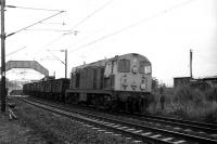 Empty mineral waggons heading to Faslane for loading with scrap metal being hauled west through Cardross by EE Type 1 no 8119 on 18 September 1972. The train will leave the West Highland line at Faslane Jct and traverse the line to No 1 Military Port where Shipbreaking Industries were cutting up various marine craft and, a few years earlier, steam locomotives.<br><br>[John McIntyre&nbsp;18/09/1972]