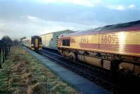 66095 with oil empties from Lairg waits for the northbound first service of the day at Muir of Ord.<br><br>[Ewan Crawford&nbsp;/02/2002]