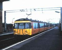 303 004 standing at Newton in August 1987 with a train for Dalmuir.<br><br>[David Panton&nbsp;/08/1987]