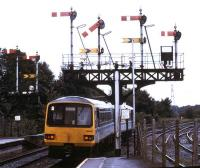 A DMU passes under the signal gantry leaving Radyr station in 1993.<br><br>[Ian Dinmore&nbsp;//1993]