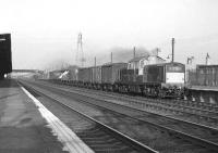 A Clayton brings a mixed freight through Hillington West on the down slow line in 1963.<br><br>[Colin Miller&nbsp;//1963]
