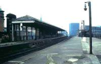 The disused ECML platforms at Manors station in 1985 looking west along platform 8 with 9 on the left. The subway at the end of the platform led down to a station entrance on the corner of Melbourne Street and Trafalgar Street and featured in an evocative scene from the 1971 film <I>'Get Carter'</I>. Platforms 6 & 7, beyond the fence on the right, are still used by a small number of local stopping services. [See image 13169]<br><br>[David Panton&nbsp;//1985]