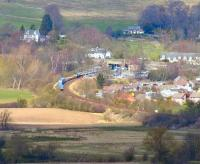 Looking north from Stirling Castle towards Bridge of Allan on 15 April 2008 with a container train about to pass through the station.<br><br>[John Furnevel 15/04/2008]