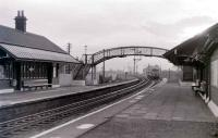 A Metro Cammell 3-car set forming the 1532 ex-Kilmarnock runs into Lugton on Saturday 5 November 1966. This was the last day on which scheduled passenger trains stopped at Lugton with official closure taking place two days later on Monday 7th.<br><br>[Colin Miller&nbsp;05/11/1966]