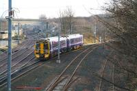 The 1225 Bathgate - Newcraighall <I>crossrail</I> service turns south off the east coast main line at Portobello Junction on 14 December 2007 heading for its penultimate stop at Brunstane.<br><br>[John Furnevel&nbsp;14/12/2007]