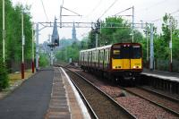 Westbound service entering Paisley St James. The junction for Glasgow Airport will be behind the train, just shy of the current station with the line running off to the left.<br><br>[Ewan Crawford&nbsp;10/05/2008]