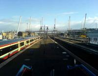 View south at Stirling on 13 March showing the new pedestrian bridge under construction across the station. On the left stands a First ScotRail Glasgow - Stirling service, soon to be extended to Alloa. <br><br>[Veronica Inglis&nbsp;13/03/2008]