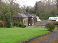Chatburn has been closed since 1962 but the main station building survives in connection with a caravan storage park and is seen here from the approach road. <br><br>[Mark Bartlett&nbsp;30/04/2008]