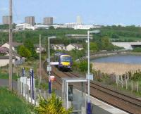 The 1351 Dundee to Glasgow Turbostar about to pass through Invergowrie. In the background are the high flats and hospital at Ninewells.<br><br>[Brian Forbes&nbsp;14/05/2008]