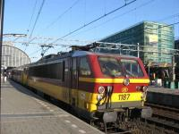 Belgian Railways electric loco number 1187 gets ready to depart Amsterdam with the 18.56 service to Brussels service on a sunny Sunday evening.<br><br>[Michael Gibb&nbsp;18/05/2008]