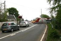 The 0646 Euston - Glasgow Central Pendolino service runs over Cleghorn level crossing on 15 May 2008. Part of the former station masters house can be seen on the left.<br><br>[John Furnevel&nbsp;/05/2008]