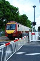 Westbound at Cambus level crossing on the first day of public service.<br><br>[Ewan Crawford&nbsp;19/05/2008]