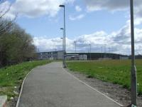 Looking east, the path runs along the approximate line of the trackbed of the Pasiely & Barrhead district railway at the location of Dykebar station. The location is now St. Andrews High School in Paisley. The building on the centre right in the background also sits on the trackbed, and it reappears at that point.<br><br>[Graham Morgan&nbsp;05/04/2008]